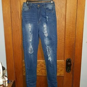 Skinny distressed jeans from Fashion Nova